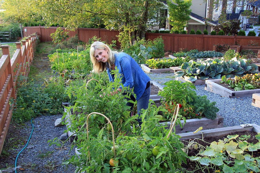 happy-and-healthy-woman-working-in-her-garden
